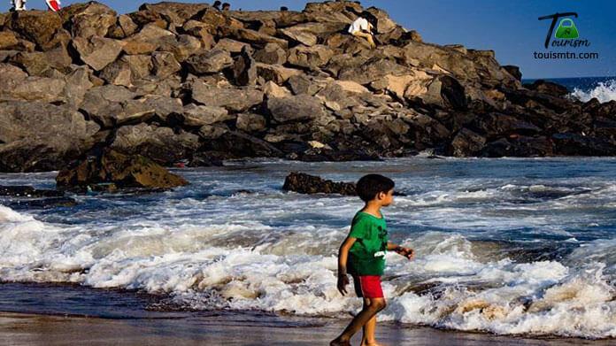 Playing kid with water at mahabalipuram beach